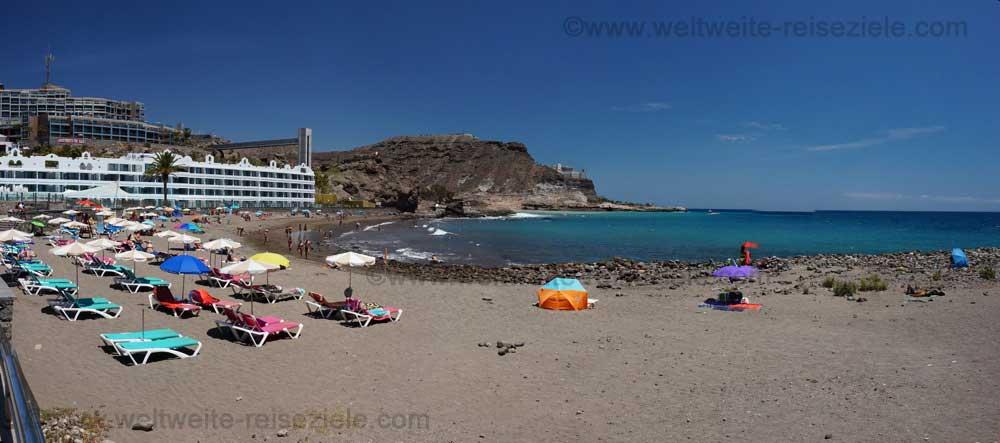 Sandstrand mit Steinen durchsetzt von Playa del Cura, Gran Canaria